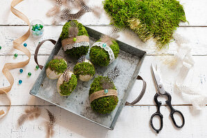 Handmade concrete Easter eggs wrapped in moss