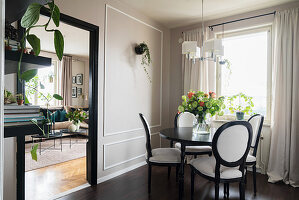 Medallion chairs in dining room with grey panelled walls