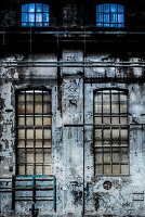 Old factory with barred windows