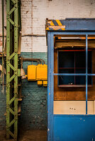Blue office cubicle in old factory