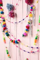 Garlands of colourful pompoms