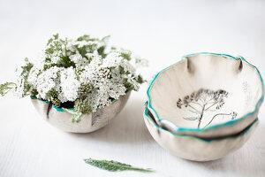 Yarrow (Achillea millefolium) in ceramic bowls