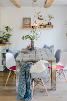Rustic wooden table in dining room with autumn decorations