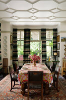South African cotton print Obama table cloth in dining room with curtains and turkish rug on floor