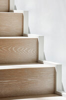 Detail of modern wooden staircase in sunshine