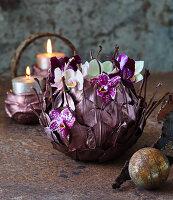 Arrangement of moth orchids decorating table