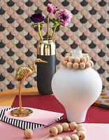 Feminine still-life arrangement in shades of pink and gold