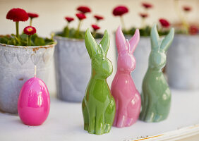 Easter-bunny candles decorating table
