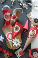 Handmade red and beige paper cones for Advent calendar