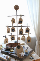Advent calendar handcrafted from twigs and paper houses