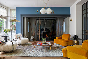 Retro chairs and coffee table in front of fireplace