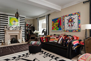 Clock-face rug in front of black sofa with colourful designer scatter cushions