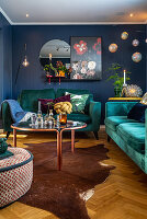 Teal sofa set in interior with blue walls
