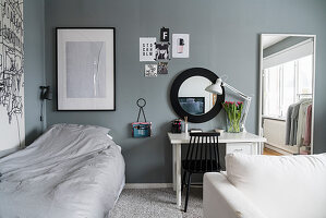 Sofa, desk and bed in teenager's bedroom in grey and white