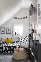 Black-and-white child's bedroom in attic
