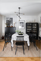 Black chairs around table in vintage-style dining room