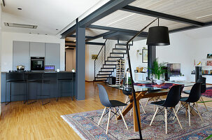 Modern loft apartment with staircase leading to mezzanine on steel joists