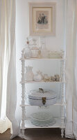 Vintage ornaments on white shelves