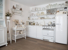 Vintage-style kitchen-dining room decorated entirely in white