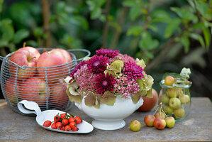 Arrangement of hydrangeas, sedum, chrysanthemums, apples and crab apples