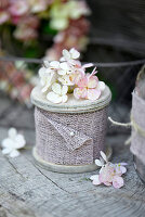 Reel of hessian ribbon decorated with hydrangea florets