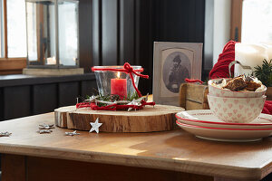 Christmas decorations and crockery in red and white on wooden table