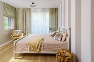 Striped wall in bedroom in pastel shades