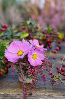 Posy of cosmos and heather in resin pot
