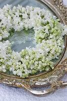 Wreath of white lilac on vintage mirror