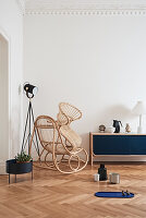 Rattan rocking chair, standard lamp and low sideboard