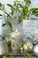 Advent-calendar bags, candle, mistletoe and baubles