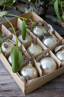 Box of old Christmas-tree baubles and mistletoe