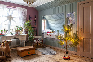 Cubby bed and vintage desk in festively decorated child's bedroom