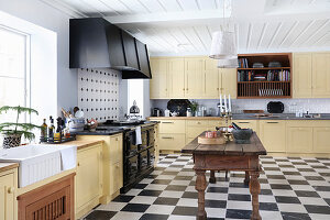 Large, country-house kitchen-dining room with chequered floor