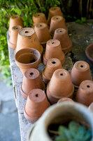 Upturned terracotta plant pots in garden