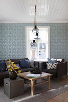 Blue wallpaper in Scandinavian-style living room