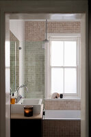 Small bathroom with beige mosaic tiles