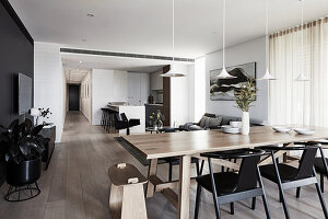 Modern, open-plan interior with colour scheme in shades of grey
