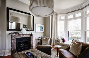 Classic living room in shades of brown with bay window