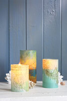 Candle lanterns with covers made from transparent mapss