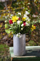Natural spring bouquet in old metal jug