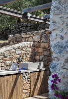 Sink in outdoor kitchen of Italian stone house