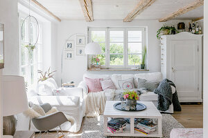 Summer flowers in bright, shabby-chic living room