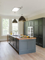 Island counter in elegant kitchen with grey furnishings