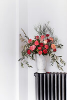 Bouquet of roses, carnation and olive branches
