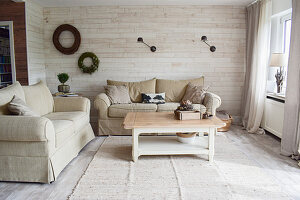 Bright, beige living room in country-house style