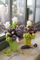 Bouquet with purple carnations, aubergines and green viburnum