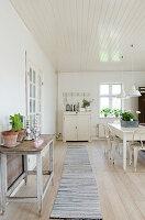 Long runner in the white Scandinavian style dining room