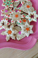 Artfully decorated cookies on a pink tray