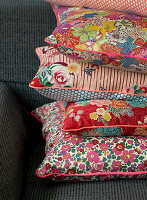 Cushions with various floral fabrics and piping
